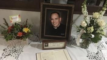 Fr Daniel Cooper Table with Portrait